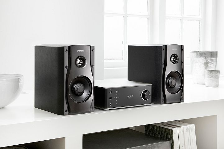Denon DRA-100 angled with Definitive Technology Studio Monitor 45